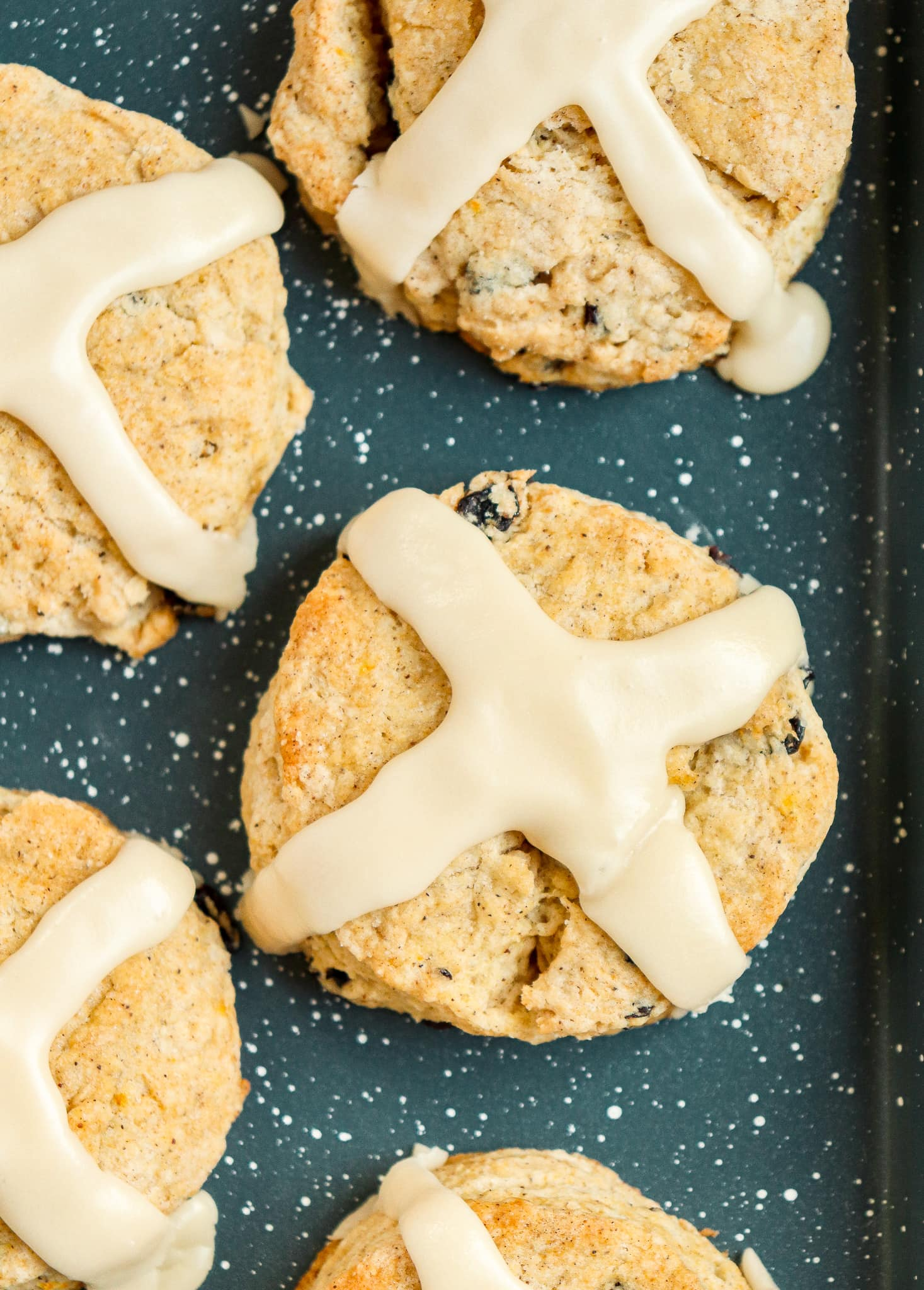 spiced currant scones with cross-shaped icing on top