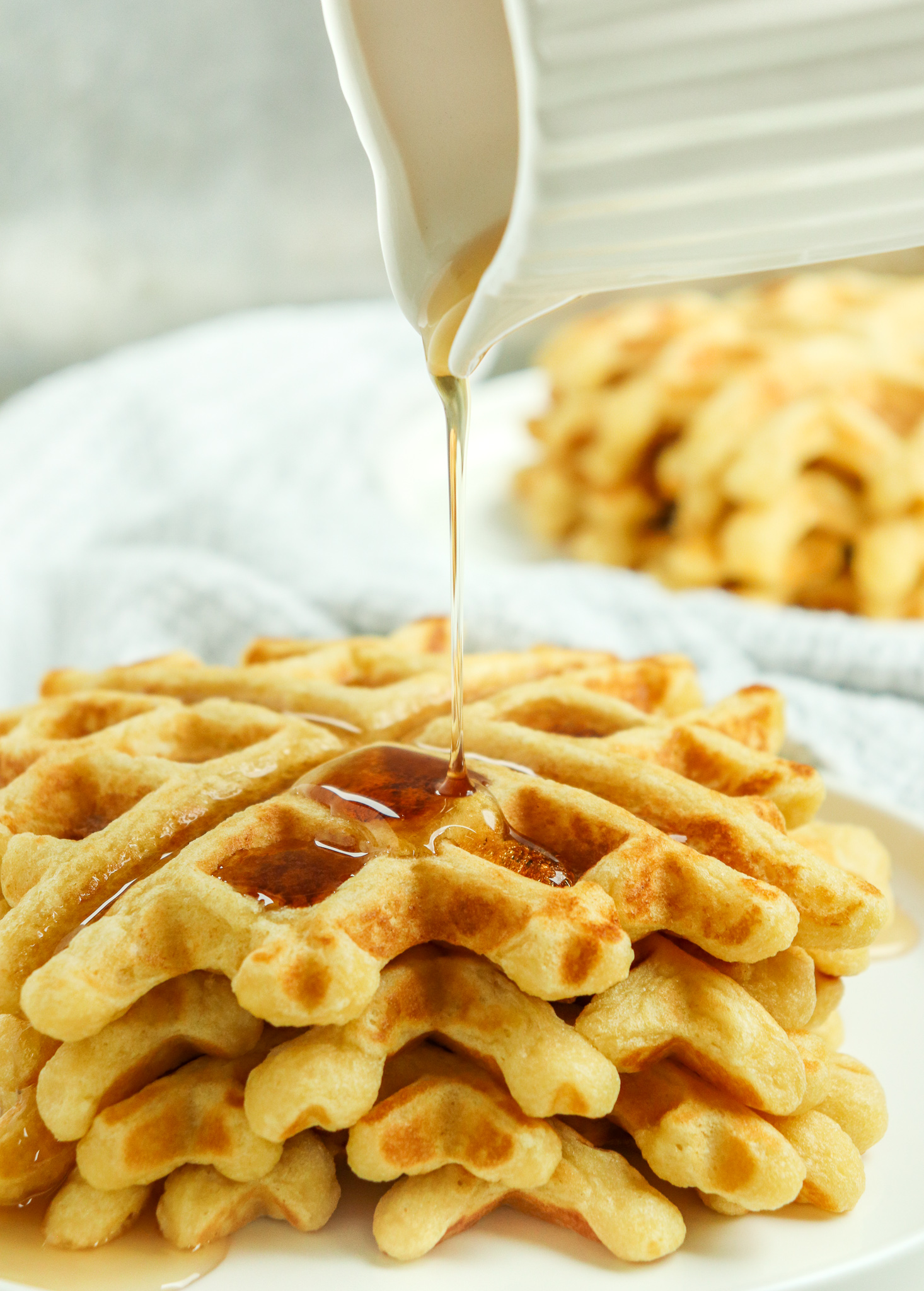 syrup being poured onto stack of Easy Homemade Waffles
