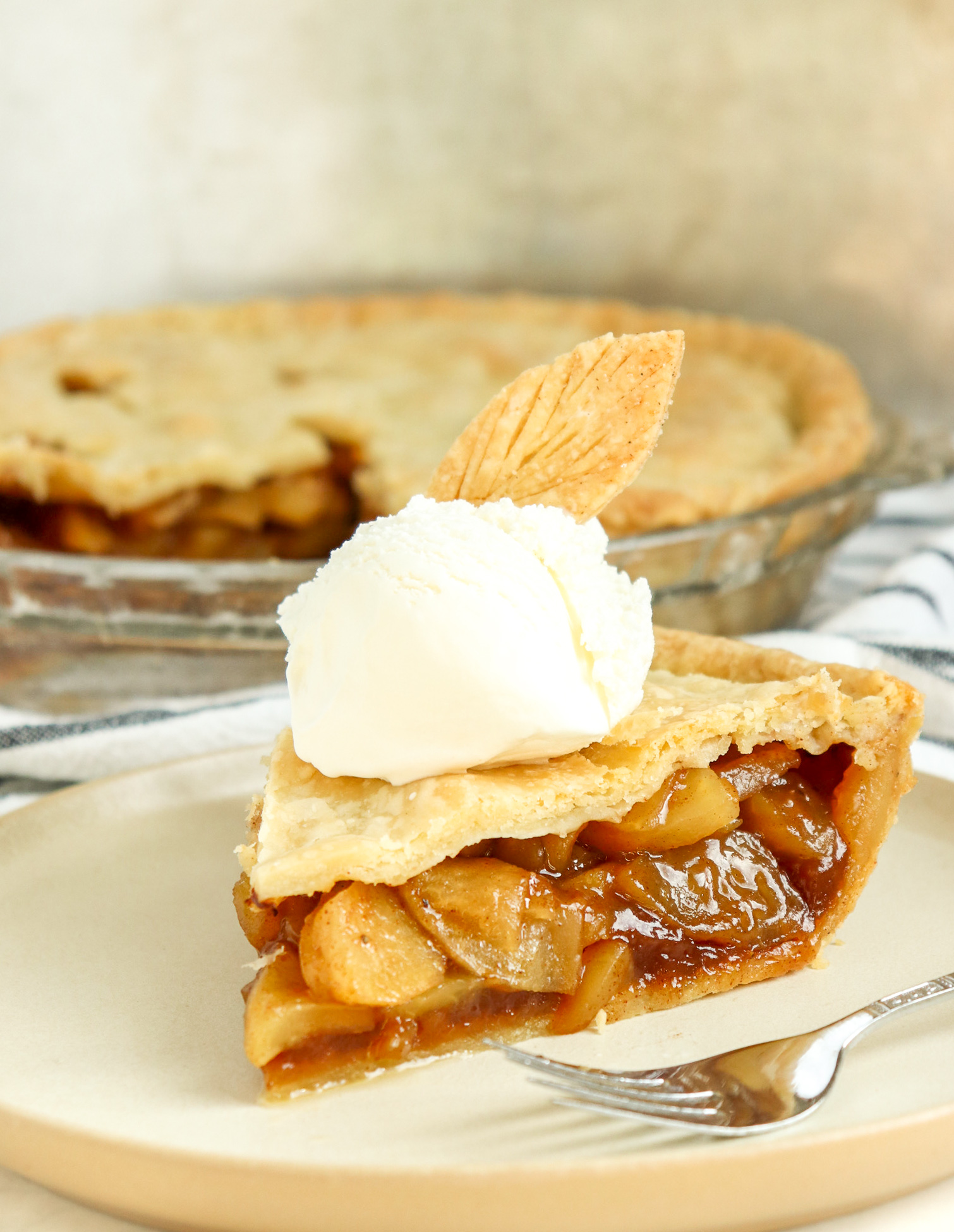 slice of apple pie with vanilla ice cream on top